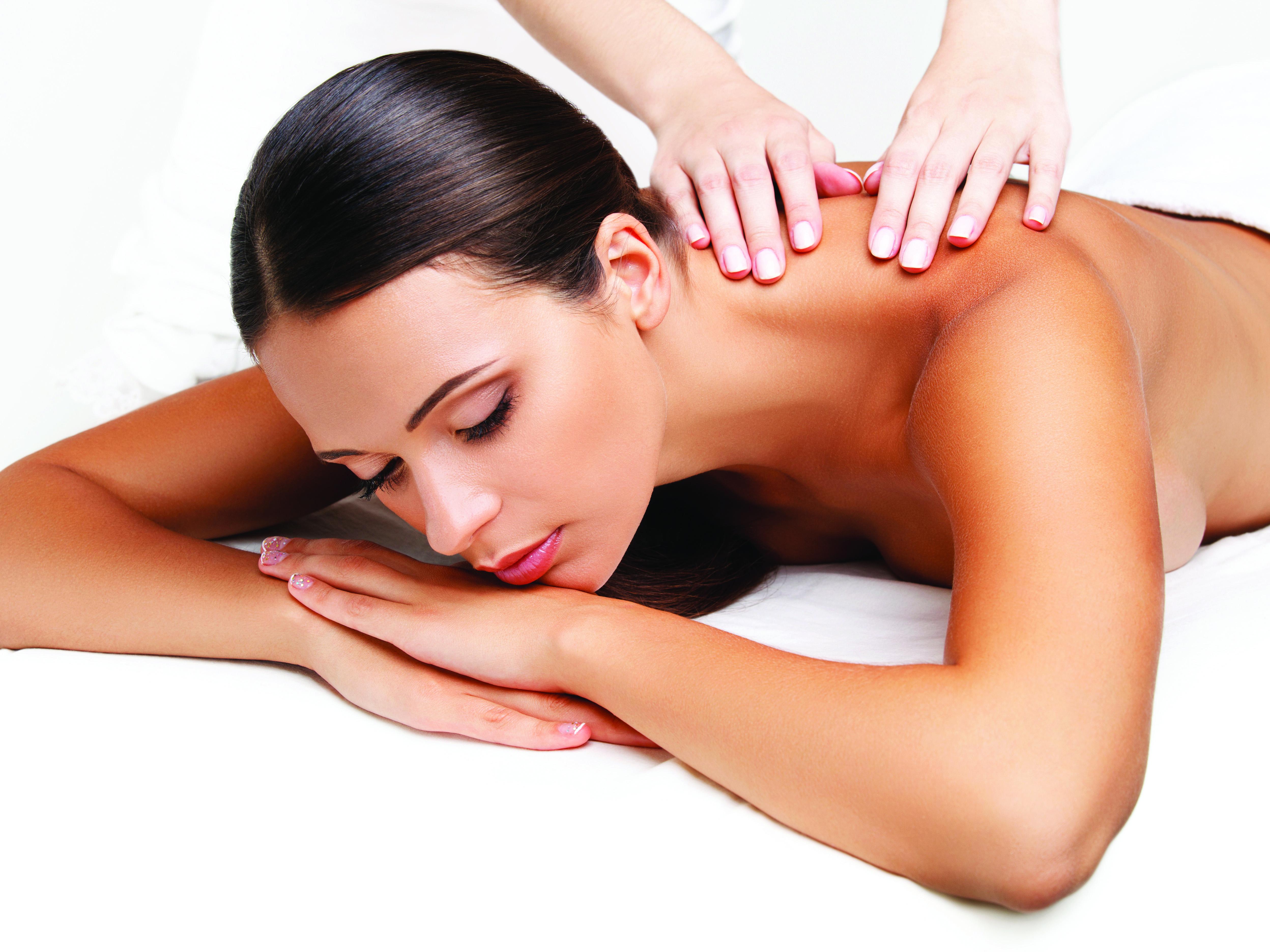 Woman having massage on beauty table