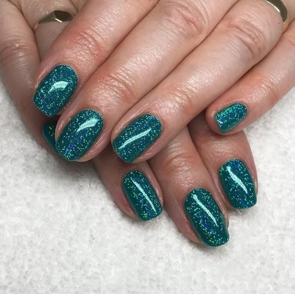 How mesmerising are these glitter green nails Stunning set byhellip